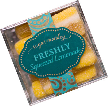 Sour lemon gourmet candy packaged in a clear cube
